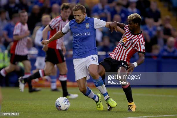 Didier Ndong of Sunderland and Almen Abdi of Sheffield Wednesday in action during the Sky Bet Championship match between Sheffield Wednesday and...