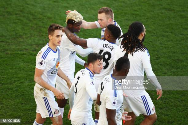 Didier Ndong of Sunderland celebrates scoring his team's second goal with team mates during the Premier League match between Crystal Palace and...