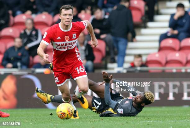 Didier N'Dong of Sunderland is floored by the challenge of Jonny Howson of Middlesbrough during the Sky Bet Championship match between Middlesbrough...