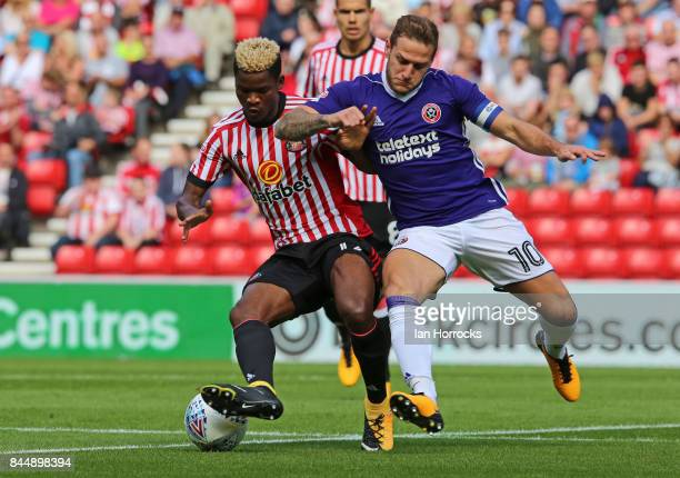 Didier N'Dong of Sunderland under pressure from Billy Sharp of Sheffield during the Sky Bet Championship match between Sunderland and Sheffield...