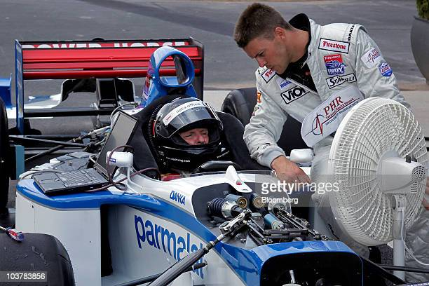 Didier Theys, left, and Jan Heylen of World Class Driving, tune and test an Arrows Yamaha A18 720-horsepower Formula One race car at Monticello Motor...