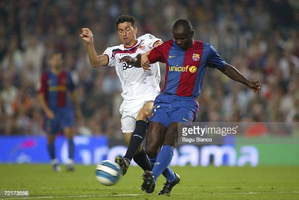 Didier Thuram of Barcelona and Marti of Sevilla in action during the La Liga match between FC Barcelona and Sevilla played at the Camp Nou stadium on...