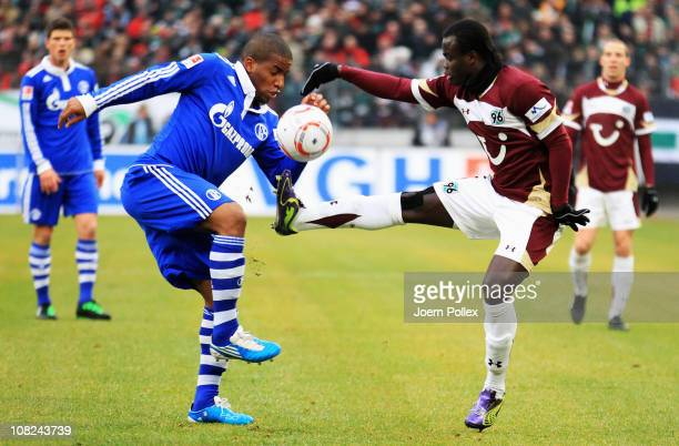 Didier Ya Konan of Hannover and Jefferson Farfan of Schalke compete for the ball during the Bundesliga match between Hannover 96 and FC Schalke 04 at...