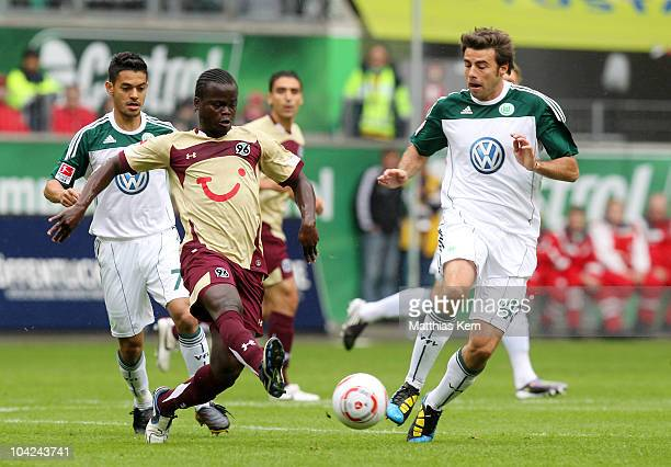 Didier Ya Konan of Hannover battles for the ball with Andrea Barzagli of Wolfsburg during the Bundesliga match between VFL Wolfsburg and Hannover 96...