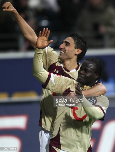 Didier Ya Konan of Hannover celebrates the third goal with Mohammed Abdellaoue of Hannover during the Bundesliga match between Eintracht Frankfurt...