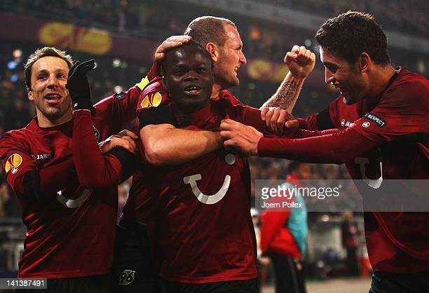 Didier Ya Konan of Hannover celebrates with his team mates after scoring his team's third goal during the UEFA Europa League second leg round of 16...