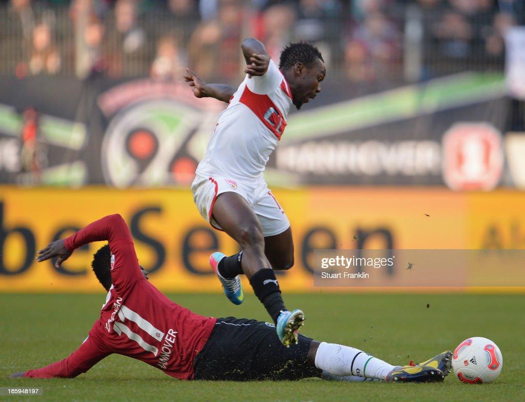 Didier Ya Konan of Hannover is challenged by Arthur Boka of Stuttgart during the Bundesliga match between Hannover 96 v VfB Stuttgart at AWD Arena on April 7, 2013 in Hannover, Germany.