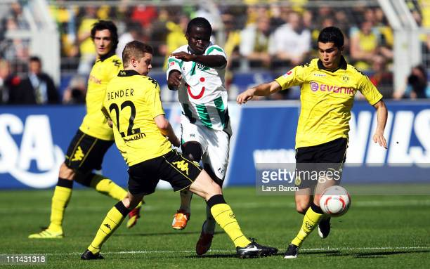 Didier Ya Konan of Hannover is challenged by Sven Bender and Nuri Sahin of Dortmund during the Bundesliga match between Borussia Dortmund and...