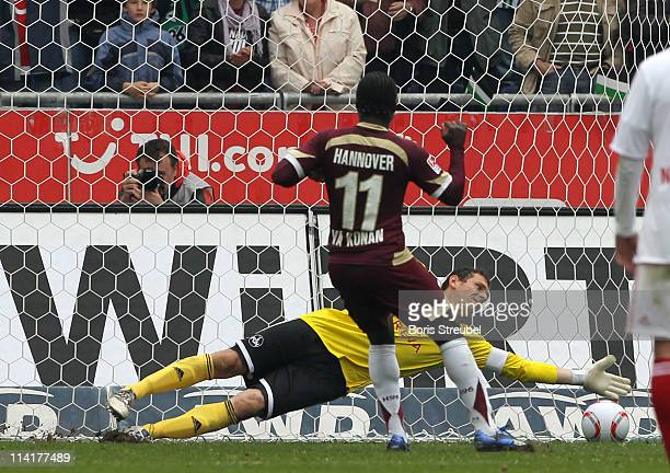 Didier Ya Konan of Hannover scores his teams 3rd goal by penallty against goalkeeper Raphael Schaefer of Nuernberg during the Bundesliga match...