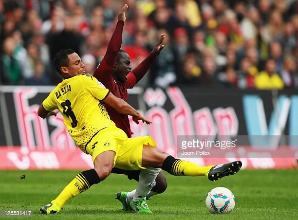 Didier Ya Konan of Hanover and Antonio da Silva of Dortmund battle for the ball during the Bundesliga match between Hanover 96 and Borussia Dortmund...
