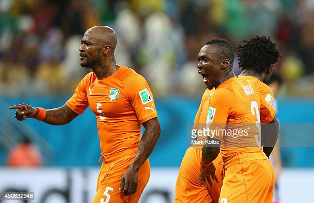 Didier Zokora and Arthur Boka of the Ivory Coast celebrate the goal of Wilfried Bony during the 2014 FIFA World Cup Brazil Group C match between the...