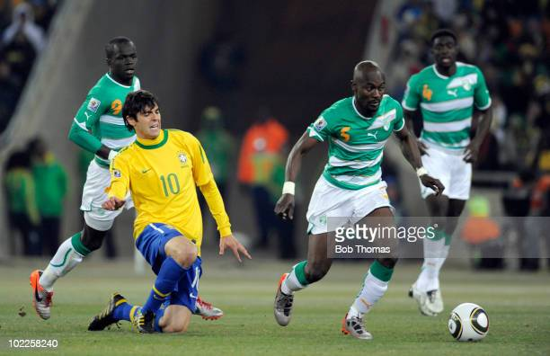 Didier Zokora of the Ivory Coast moves away from Kaka of Brazil during the 2010 FIFA World Cup South Africa Group G match between Brazil and Ivory...