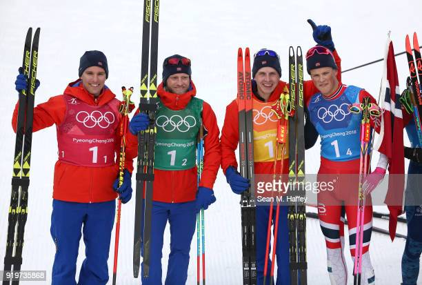 Didrik Toenseth Martin Johnsrud Sundby Simen Hegstad Krueger and Johannes Hoesflot Klaebo of Norway celebrate after winning the gold medal during...