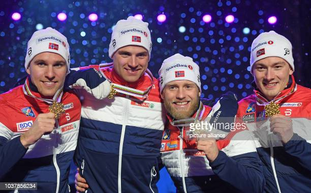 Didrik Toenseth Niklas Dyrhaug Martin Johnsrud Sundby and Finn Haagen Krogh from Norway show their men's 4x10 km crosscountry relay gold medals...
