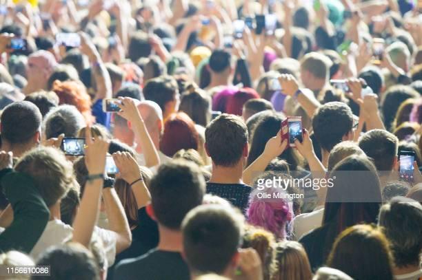 Die Antwoord fans enjoy the atmosphere as DJ HiTek performs onstage at O2 Academy Brixton on June 17 2019 in London England