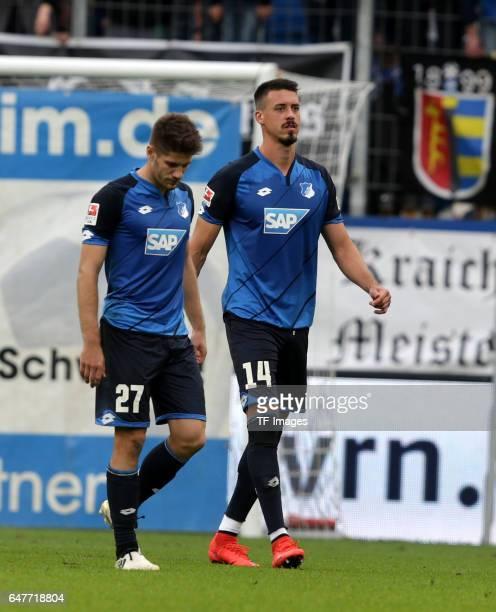 Die Beiden Torschuetzen Sandro Wagner of Hoffenheim and Andrej Kramaric of Hoffenheim gehen gemeinsam nach Spielende vom Platz looks on during the...