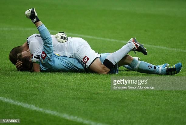 Die Borussia-Spieler Filip Daems und Torwart Marc-Andre Ter Stegen freuen sich nach dem gewonnenen Bundesliga Spiel zwischen dem FC Bayern Muenchen...