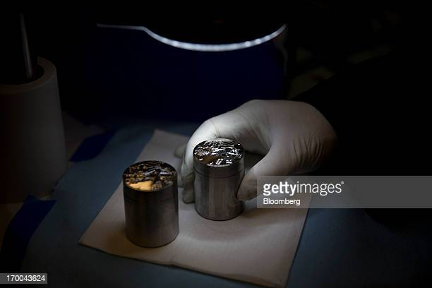 Die Finishing Specialist Dennis Flagerty inspects dies used to strike coins are inspected under a microscope at the United States Mint at West Point...