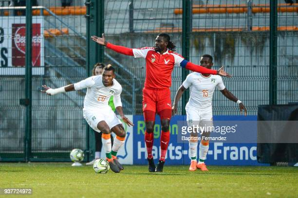 Die Geoffrey Serey of Ivory Coast and Emmanuel Adebayor of Togo during the International friendly match between Togo and Ivory Coast on March 24 2018...