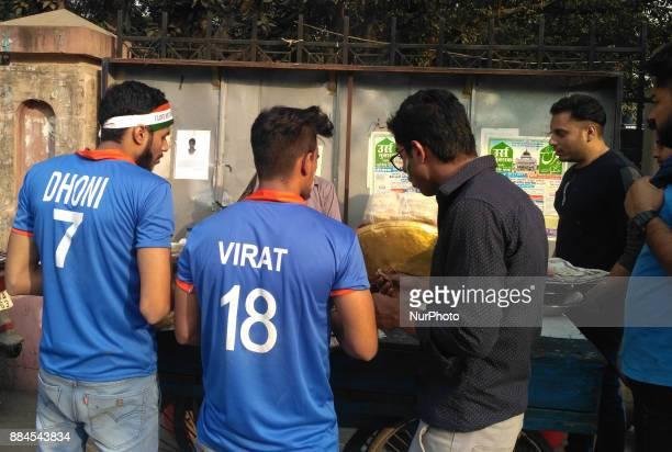 Die Hard fans of Ms Dhoni amp Virat Kohli having street food out side of Feroz Shah Kotla Ground In Delhi on the 1st day of 3rd Cricket Test match...