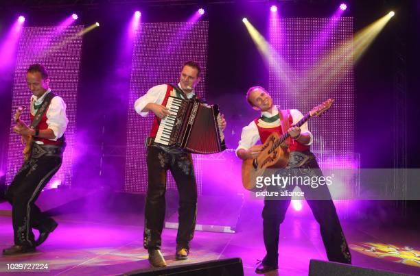Die Jungen Zillertaler Markus Michael and Daniel perform onstage during an Open Air concert in Strass im Zillertal Austria 17 August 2013 Photo Bodo...