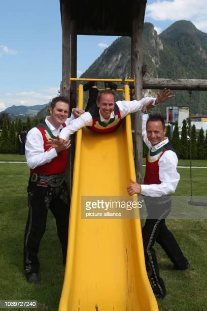 Die Jungen Zillertaler Michael Daniel and Markus pose prior to an Open Air concert in Strass im Zillertal Austria 17 August 2013 Photo Bodo Schackow...