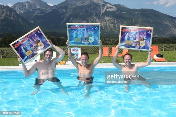 Die Jungen Zillertaler Michael Markus and Daniel pose with their CD/DVD 'JUZI open air' prior to an Open Air concert in Strass im Zillertal Austria...