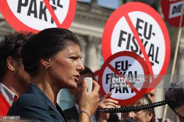 Die Linke leftwing politician Sahra Wagenknecht leads a protest against the European Union fiscal pact outside the Reichstag seat of the Bundestag on...