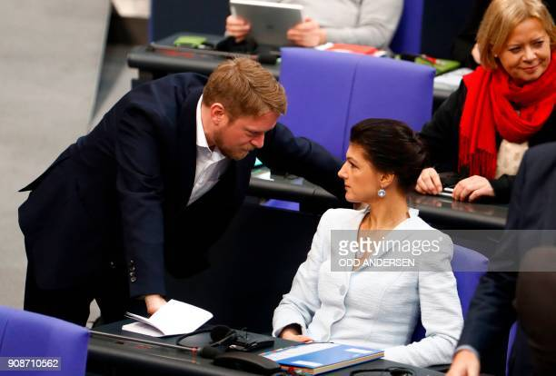Die Linke party's MP Sahra Wagenknecht talks with party member Jan Korte before a special session of the parliament to mark the 55th anniversary of...
