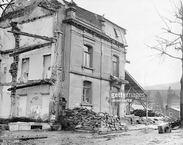 Die Ruine des ehemals 32-zimmrigen Wohn-und Geschäftshauses des TextilkaufmannsAlbert Vuidar in Houffalize , daswährend der Kämpfe Ende Dezember 1944...