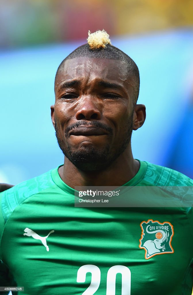 Die Serey of the Ivory Coast gets emotional during his National Anthem during the 2014 FIFA World Cup Brazil Group C match between Colombia and Cote D'Ivoire at Estadio Nacional on June 19, 2014 in Brasilia, Brazil.