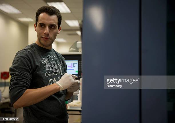 Die Setter Justin Pagan works at the United States Mint at West Point in West Point New York US on Wednesday June 5 2013 Sales of gold and silver...