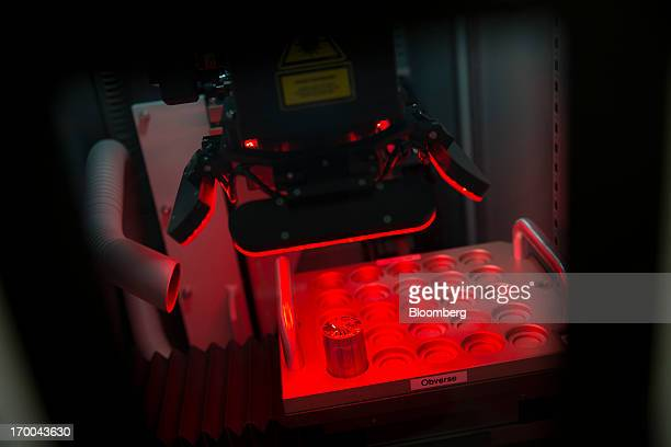 A die used to strike coins is frosted using a laser at the United States Mint at West Point in West Point New York US on Wednesday June 5 2013 Sales...
