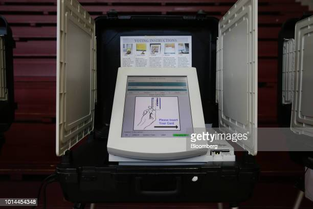 A Diebold Election Systems Inc electronic voting machine sits in a privacy booth at a polling location during the Georgia primary runoff elections in...