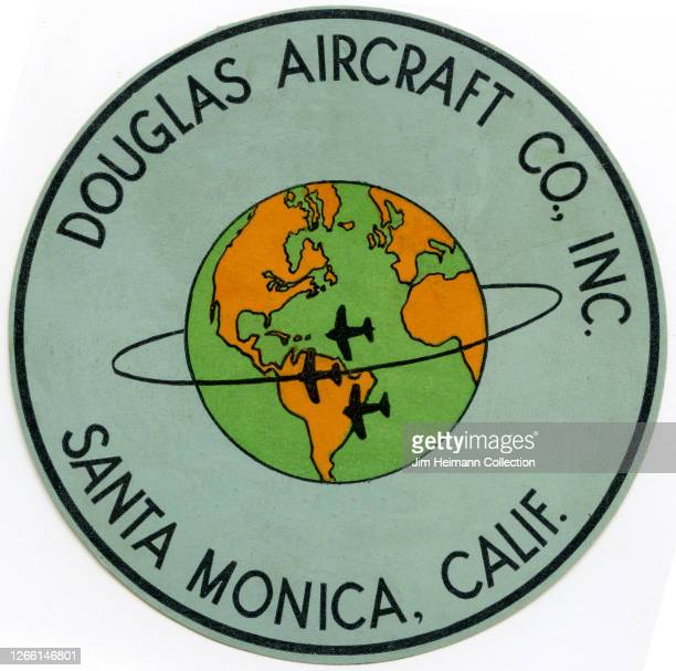 Die-cut luggage label for Douglas Aircraft in Santa Monica, California shows an image of the planet Earth with airplanes traveling around it, circa...