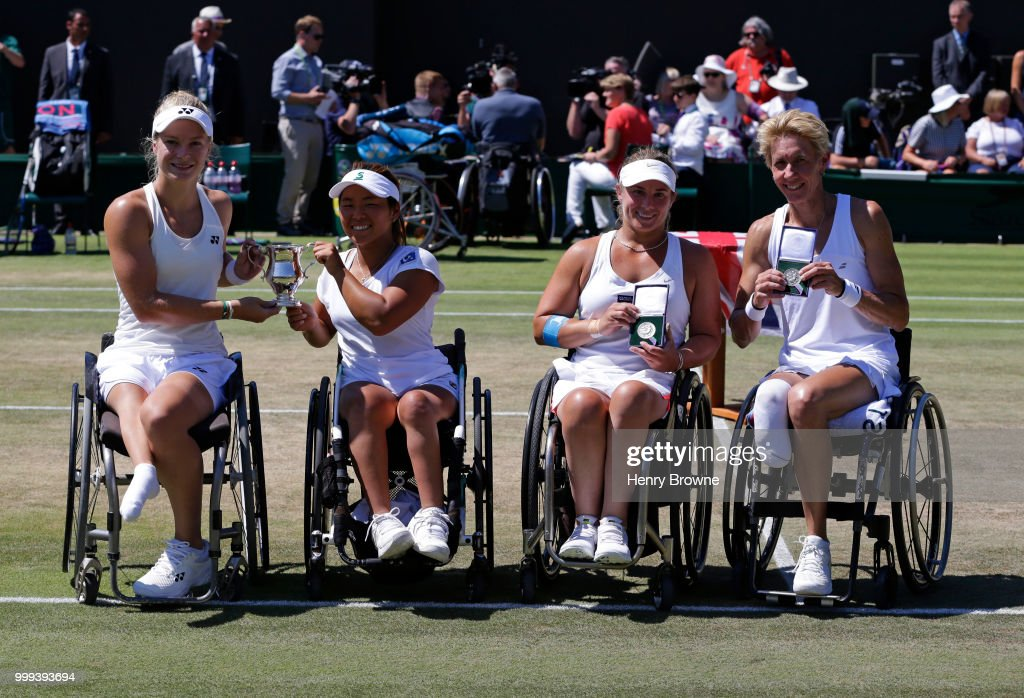 Diede De Groot of The Netherlands and Yui Kamiji of Japan after winning the womens doubles wheelchair final against Sabine Ellerbrock (r) of Germany and Lucy Shuker (2nd right) of Great Britain at the All England Lawn Tennis and Croquet Club on July 15, 2018 in London, England.