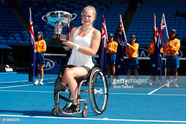 Diede De Groot of the Netherlands poses with the championship trophy after winning the women's wheelchair singles final against Yui Kamiji of Japan...
