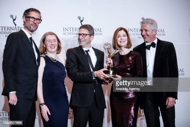 Diederick Santer Patrick Gale and Dana Delany give a pose with their award during the 46th International Emmy Awards at New York Hilton on November...