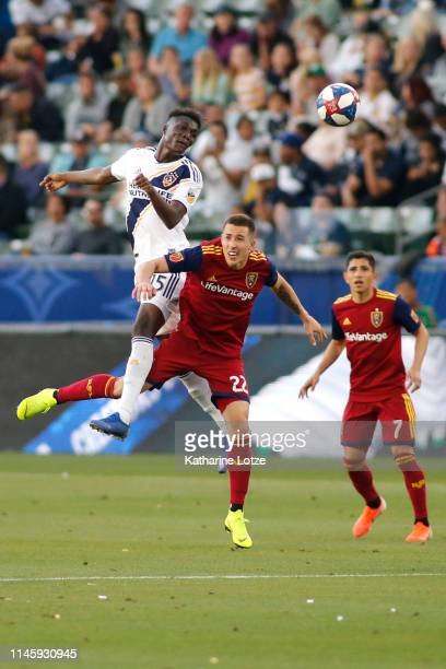 Diedie Traore of Los Angeles Galaxy and Aaron Herrera of Real Salt Lake go up for a header during a game at Dignity Health Sports Park on April 28...