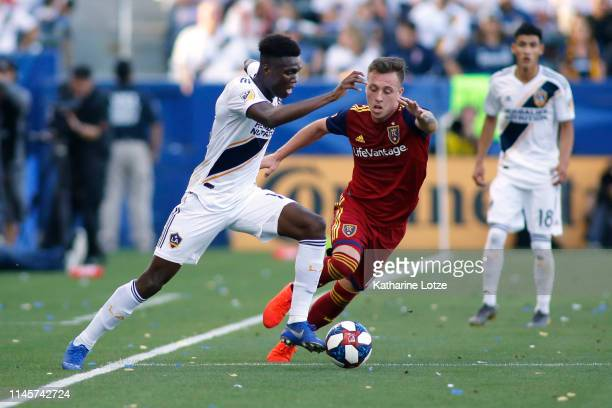 Diedie Traore of Los Angeles Galaxy and Corey Baird of Real Salt Lake fight for control of the ball during a game at Dignity Health Sports Park on...