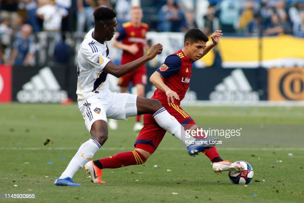 Diedie Traore of Los Angeles Galaxy and Jefferson Savarino of Real Salt Lake fight for control of the ball during a game at Dignity Health Sports...