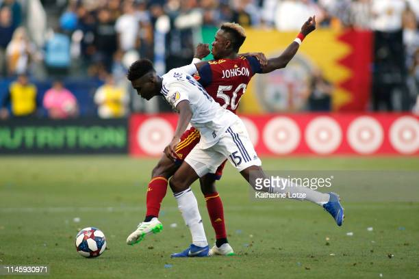 Diedie Traore of Los Angeles Galaxy and Sam Johnson of Real Salt Lake fight for control of the ball during a game at Dignity Health Sports Park on...