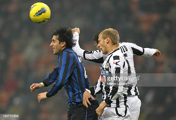 Diego Alberto Milito of FC Internazionale Milano battles for the ball Joel Ekstrand and Larangeira Danilo of Udinese Calcio during the Serie A match...