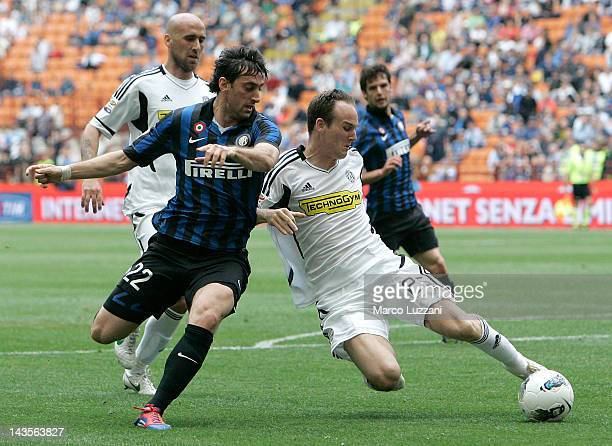 Diego Alberto Milito of FC Internazionale Milano competes for the ball with Steve Von Bergen of AC Cesena during the Serie A match between FC...