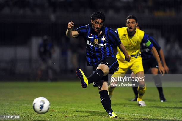 Diego Alberto Milito of FC Internazionale Milano scores the opening goal during the pre season friendly match between FC Internazionale Milano and AC...