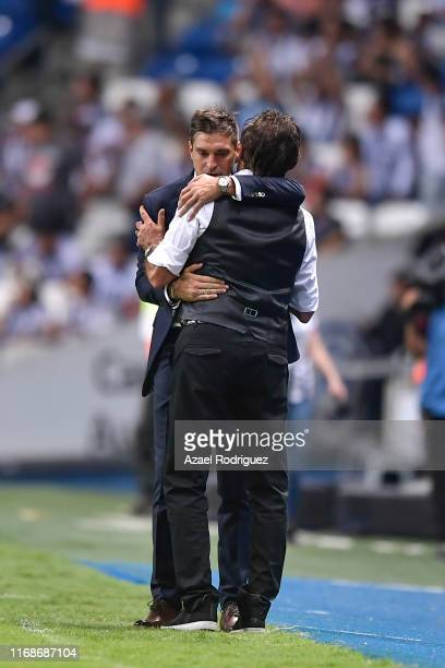 Diego Alonso coach of Monterrey talks to Ricardo La Volpe coach of Toluca at the end of the 5th round match between Monterrey and Toluca as part of...