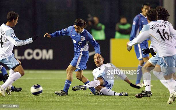 Diego Alonso of Shanghai Shenhua vies with Zdrilic David of Sydney FC during the AFC Champions League 2007 match between the Sydney FC of Australia...