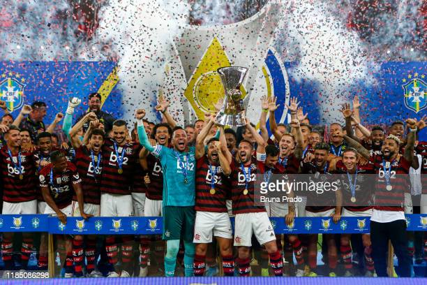 Diego Alves, Diego and Éverton Ribeiro of Flamengo lift the trophy after winning the Brasileirao 2019 after the match against Ceará at Maracana...