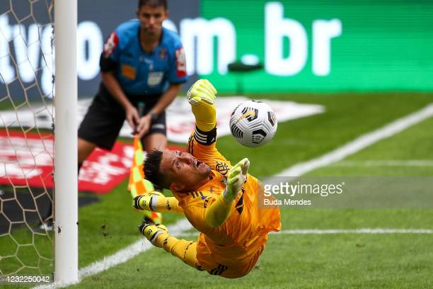 Diego Alves of Flamengo defends a penalty kick during a penalty shoot-out in the match between Flamengo and Palmeiras as part of the Supercopa do...