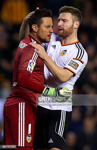 Diego Alves of Sevilla celebrates after stopping a penalty with his teammate Shkodran Mustafi during the La Liga match between Valencia CF and...